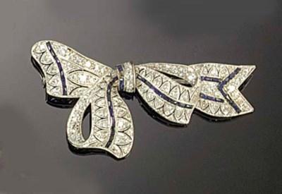 A diamond and calibré sapphire
