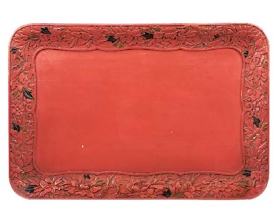 A Continental red lacquered tr
