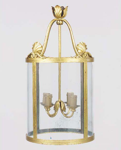A large gilt metal cylindrical