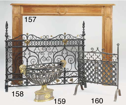 A wrought iron and brass mount