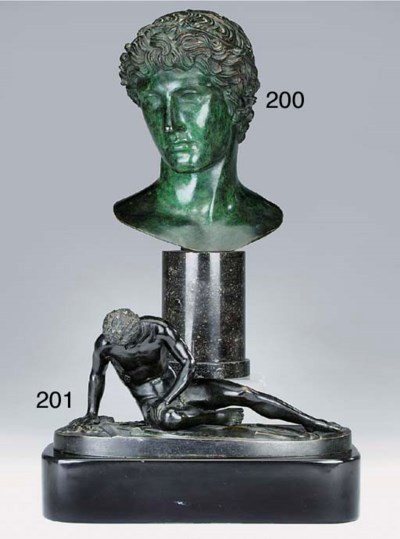 A green patinated bronze head,