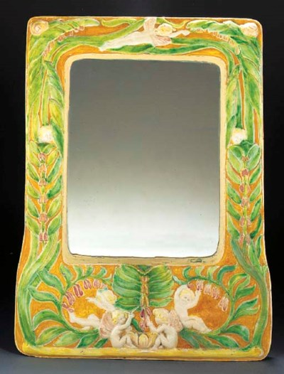 AN EARTHENWARE WALL MIRROR by