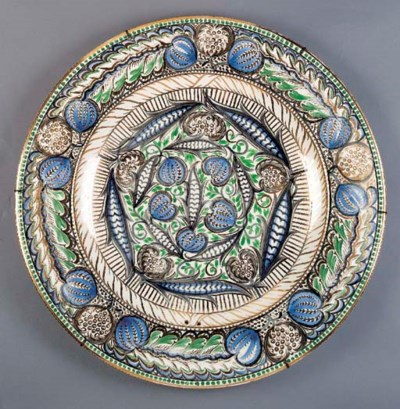 A LARGE EARTHENWARE CHARGER by