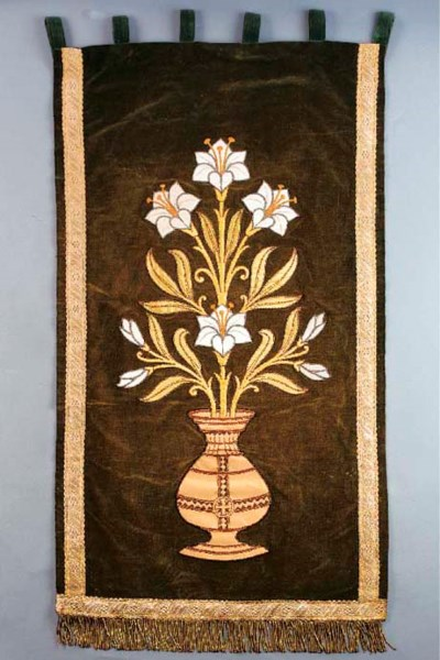 AN EMBROIDERED VELVET HANGING
