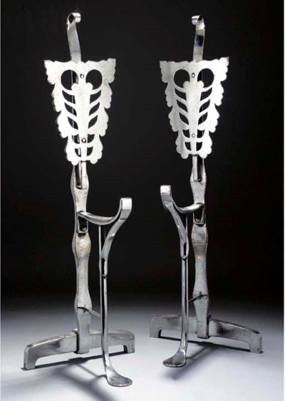A PAIR OF POLISHED STEEL FIRED