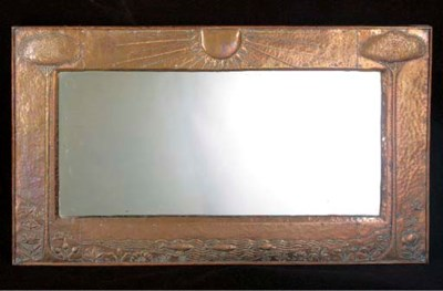 A COPPER OVERMANTLE MIRROR by