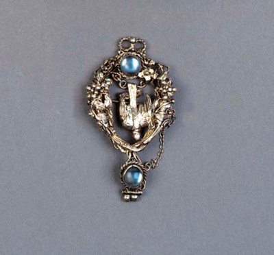 A WHITE METAL AND MOONSTONE BR