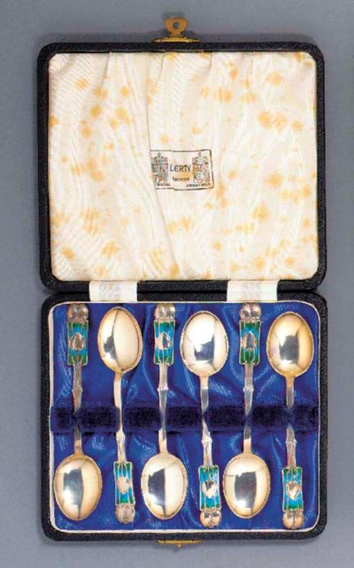 A SET OF SILVER AND ENAMEL TEA