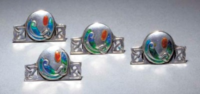 A SET OF FOUR SILVER AND ENAME