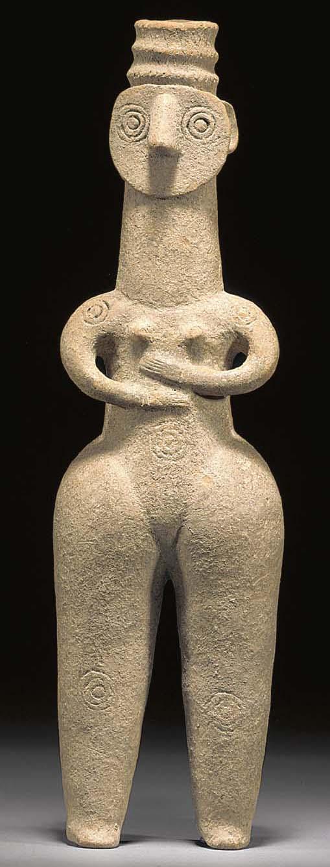 A LARGE AMLASH POTTERY FEMALE