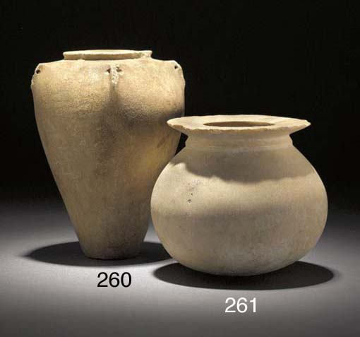 A MESOPOTAMIAN CREAM STONE JAR