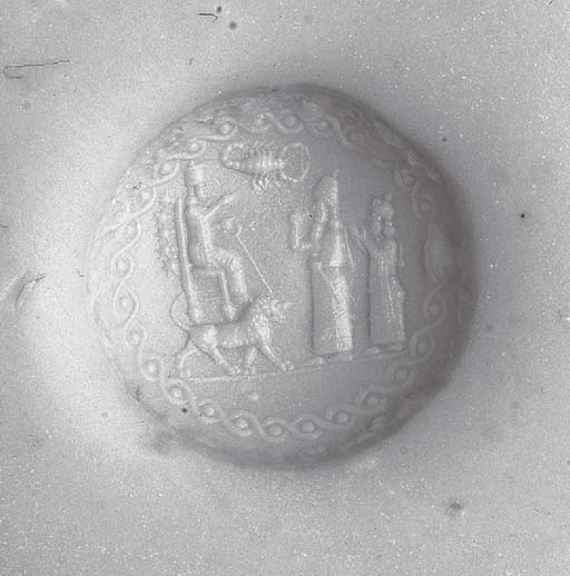 AN ASSYRIAN CHALCEDONY STAMP S