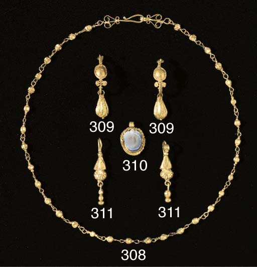 A PAIR OF ROMAN GOLD DOME AND
