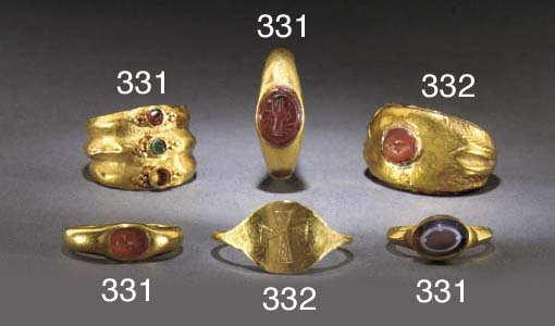 A GROUP OF FOUR ROMAN GOLD INT