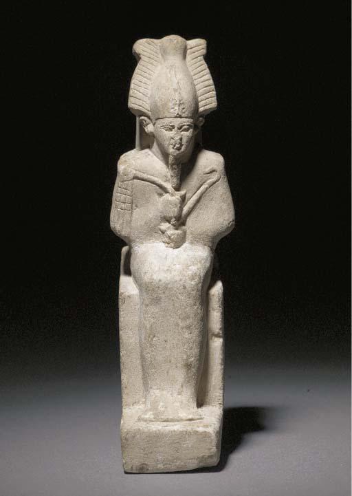 AN EGYPTIAN LIMESTONE ENTHRONE