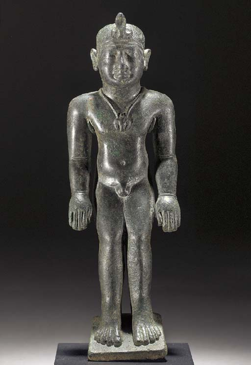 AN EGYPTO-PERSIAN BRONZE FIGUR