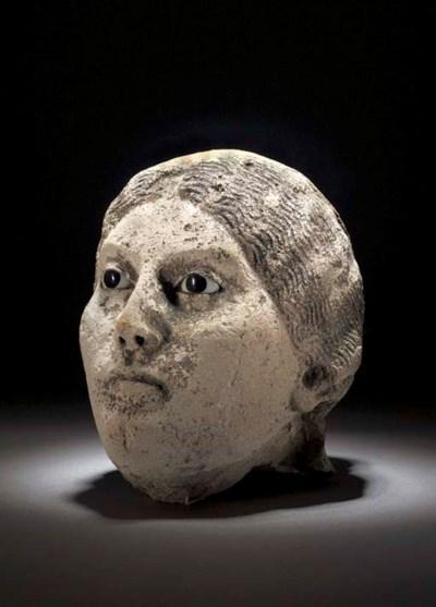 A ROMANO-EGYPTIAN PAINTED PLAS