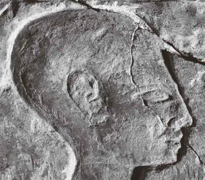 AN EGYPTIAN LIMESTONE FUNERARY