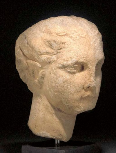 A GREEK MARBLE HEAD OF A YOUNG