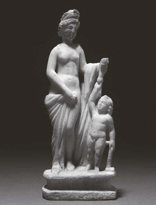 A MARBLE STATUE OF VENUS AND C