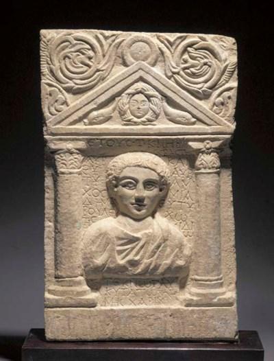 AN EAST ROMAN LIMESTONE FUNERA