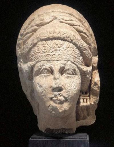 AN EAST ROMAN LIMESTONE HEAD O