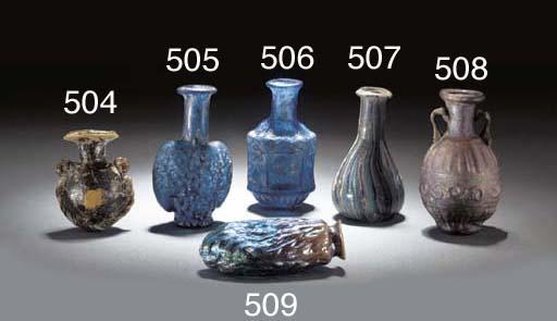 A ROMAN DARK BLUE MOULD-BLOWN