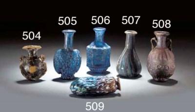 A ROMAN MOULD-BLOWN BLUE GLASS