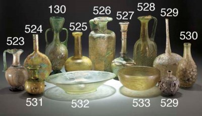 A ROMAN OLIVE-GREEN GLASS SPRI