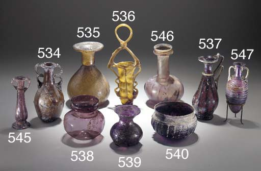A ROMAN AUBERGINE GLASS RIBBED