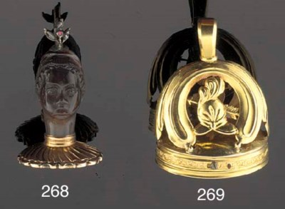 A gold musical fob seal
