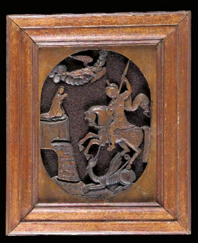 A carved wood icon of St. Geor