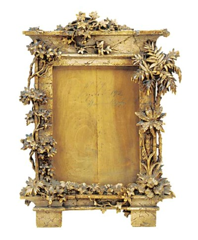 A Continental carved wood fram