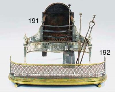 A Regency brass fender, early