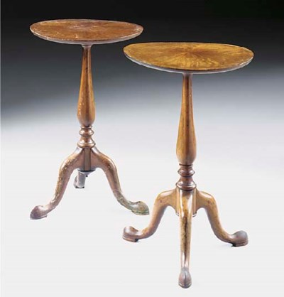 A pair of mahogany tripod tabl