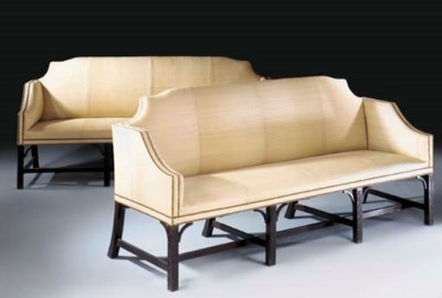 A pair of mahogany sofas, firs