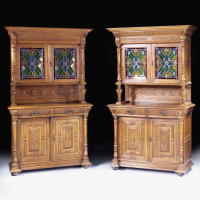 A PAIR OF CARVED OAK BUFFETS,