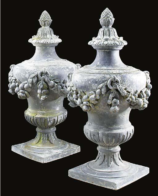 A pair of lead urn finials, ea