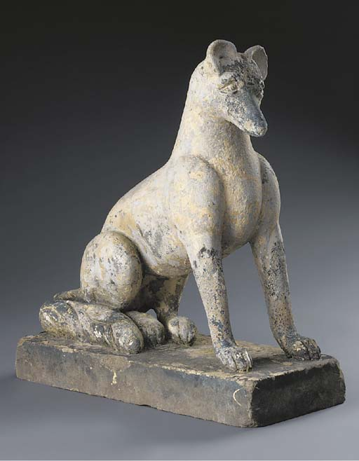 A gritstone model of a fox, 19