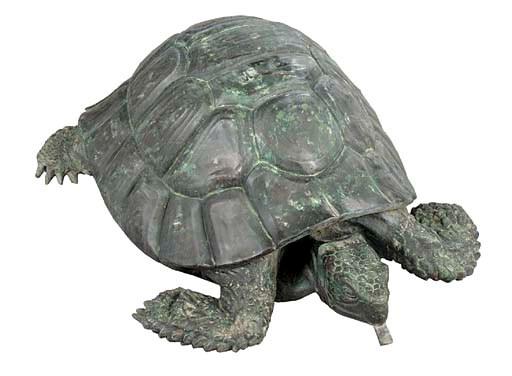 A bronze turtle fountain head,