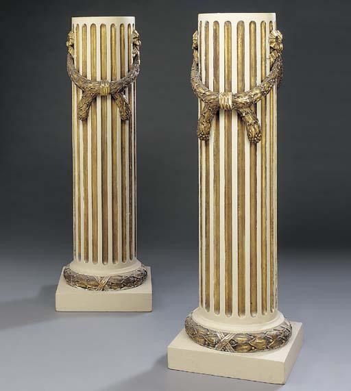 A pair of parcel gilt cream pa