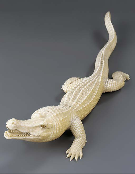 A carved ivory model of a croc