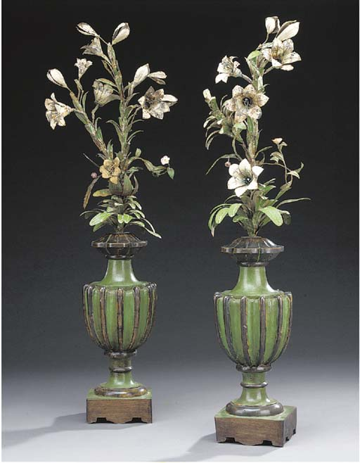 A pair of polychrome painted m