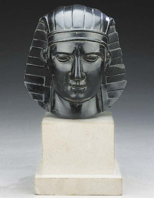A sculpted black marble bust o