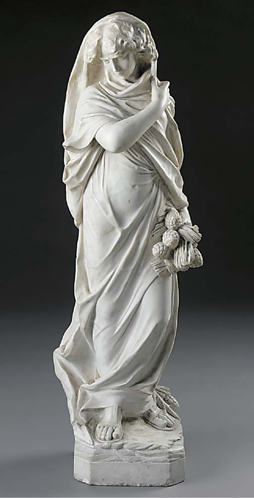 A sculpted white marble standi