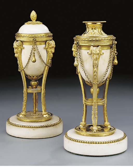 A pair of gilt bronze and whit