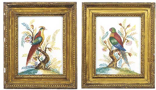 A pair of painted plaster reli