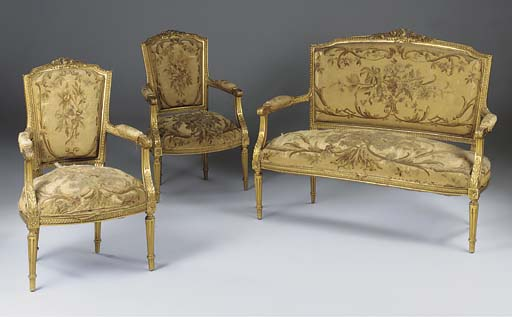 A FRENCH CARVED GILTWOOD AUBUS