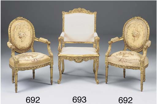 A CARVED GILTWOOD ARMCHAIR, 18