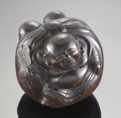 A wood netsuke of Hotei 19th C